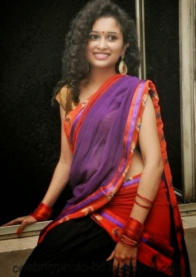 latest+Photo shoot+of+Manochitra+with+a+Hot+Pink+Sari003