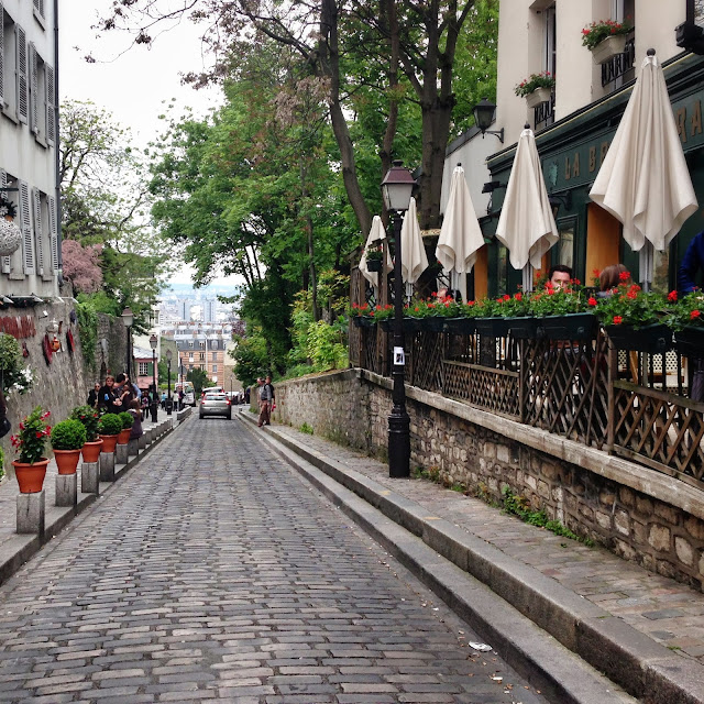 Beautiful cobblestone street in Montmartre Paris.