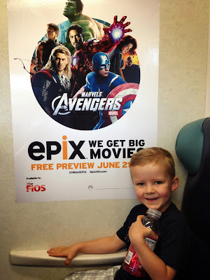 kid with avengers poster