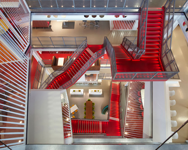Photo of an office lobby with red staircase