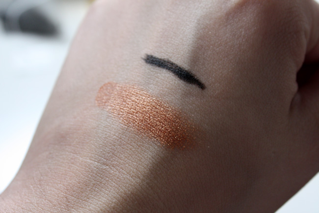 OFRA Pressed eyeshadow in Gold Rush + OFRA eyeliner in black swatch