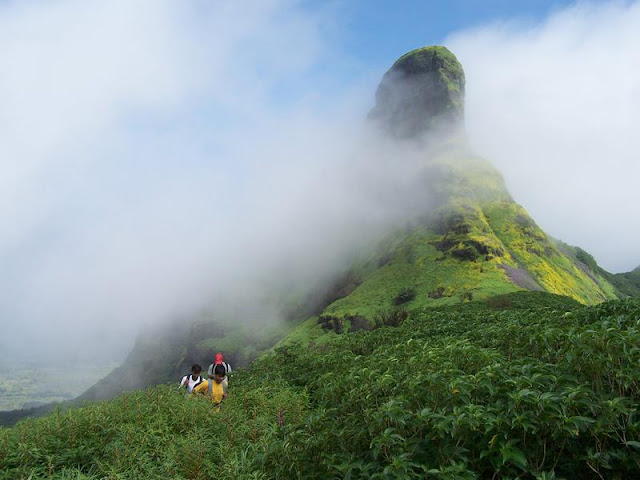 Men walking below Rathnagiri Hills