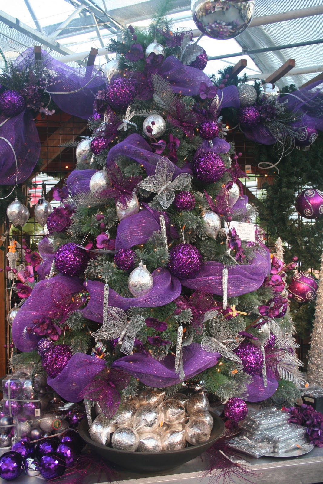Christmas tree decorations purple and silver - Last Year We Had A Beautiful Red And Green Upside Down Tree At The Entrance Of The Garden Center This Year I Didn T Know How The Designers Would Top It