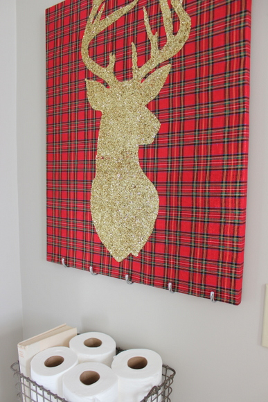 This gold reindeer on holiday canvas is great Christmas decor.
