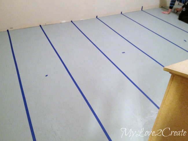 taped strips on subfloor, ready for paint, sealing tape for perfect paint lines