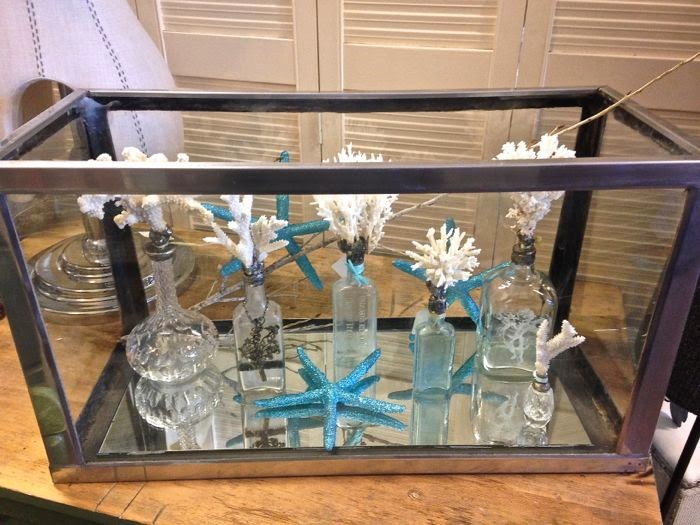 Repurposed vintage aquarium display for coral bottles The Pickled Hutch