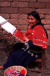 Tzeltal Maya Indian woman from Tenejapa, Chiapas, Mexico weaves on a backstrap loom