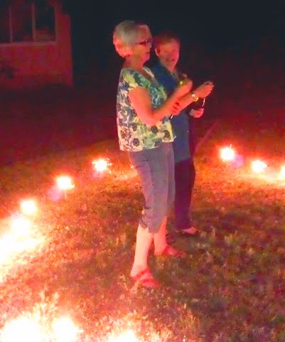 """""""Ya-Ya Sisters"""" in a circle of sparklers"""