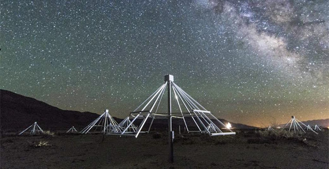 A night-time shot of some of the antennas of the OV-LWA with the center of our galaxy in the background. Credit: Gregg Hallinan/Caltech
