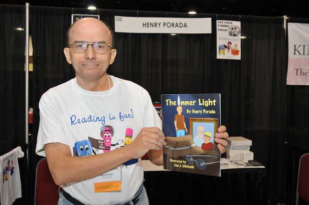 Author holding his first published book