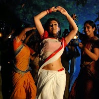 Dancing Nayantara exotic photo gallery in white and red saree