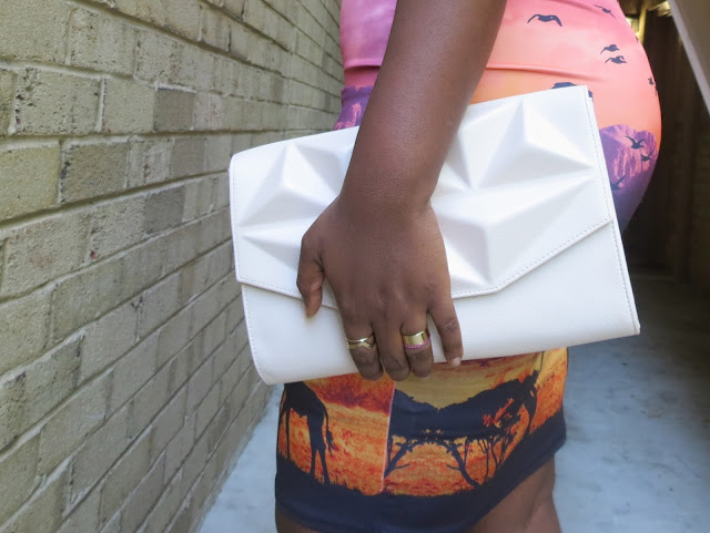 MIDI SKIRT, PINK CLUTCH, STACKED RINGS