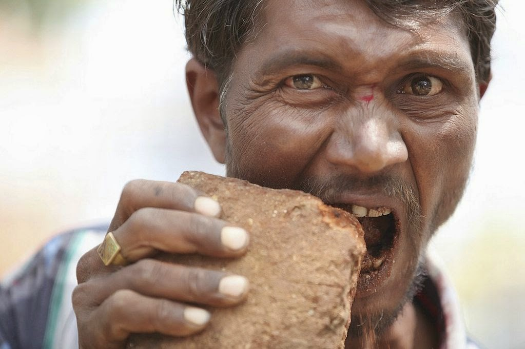 indian man eating bricks