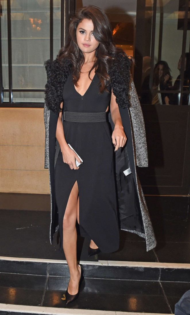 Selena Gomez bares cleavage in a plunging dress in London