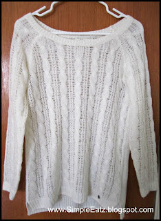 White knitted sweater.