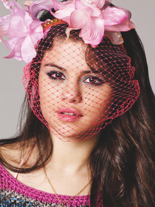 Selena Gomez wears basketball jersey over a bikini top for the cover of Nylon, February 2013