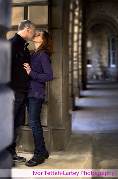 A 12 image panorama montage image of engaged couple kissing.