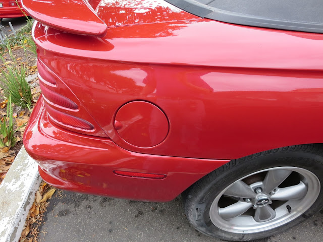 Dented quarter panel repaired by Almost Everything Auto Body