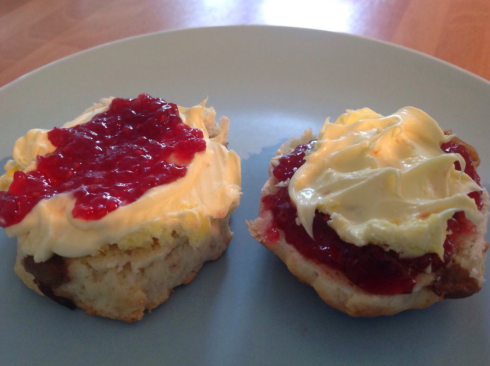 two scones with cream and jam