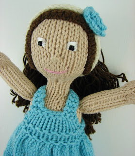 close up of knit doll