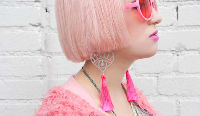 Iris Apfel sunglasses, tassel earrings, neon pink accessories
