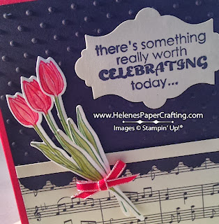 closeup of birthday card with sheet music and flowers