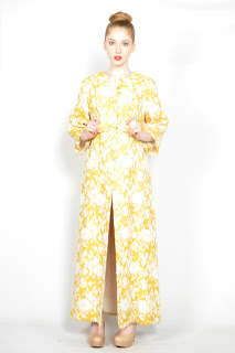 Vintage 1960's yellow and gold brocade maxi jacket with bow detail in front.