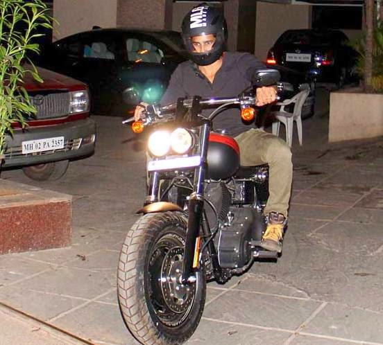 Sidharth Malhotra snapped outside Karan Johar's house on a bike