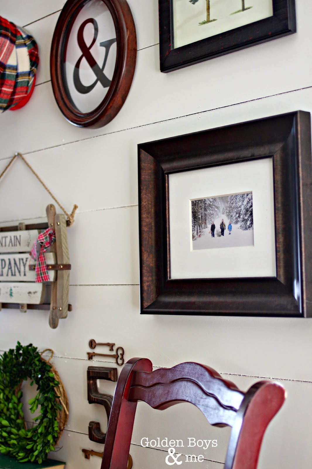 Winter themed gallery wall on plank wall with ampersand-www.goldenboysandme.com