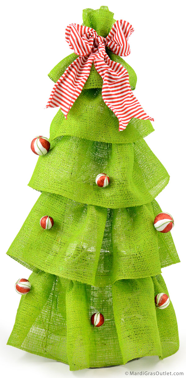 Sparkly candy striped balls and a striped bow on our ruffled burlap Christmas tree.