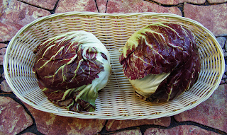 Two Large Heads of Radicchio in a Basket