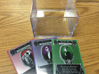 Three Gloom character groups in matching color card sleeves