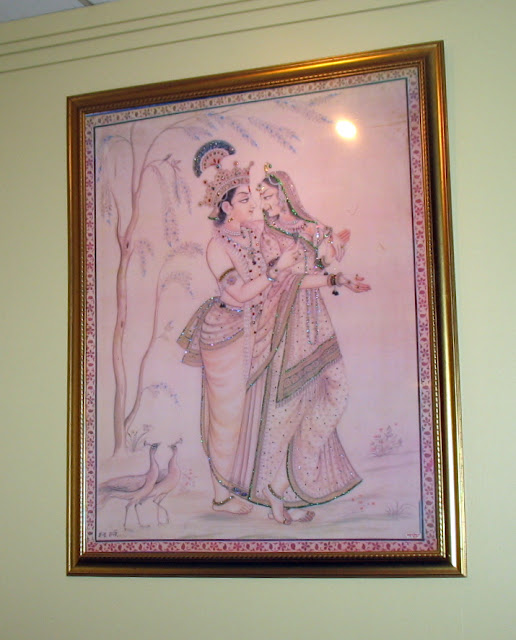 An Indian painting on the wall.