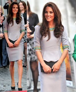 Kate In A Tailored Dress With Colorful Embellishments