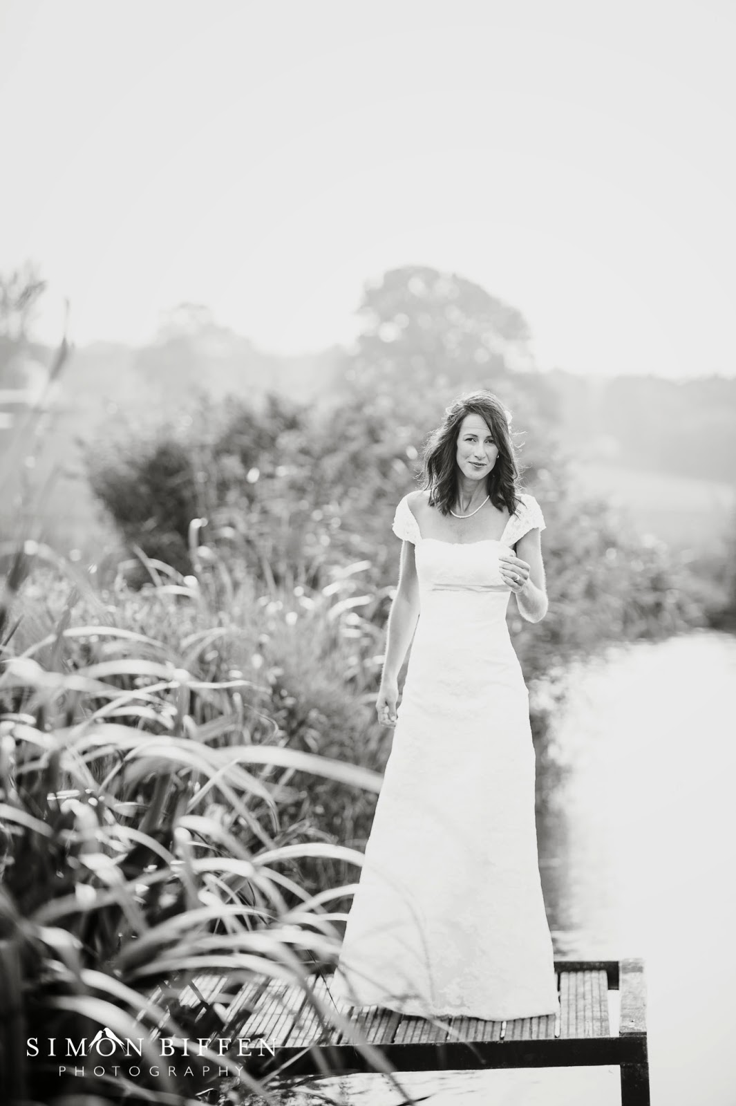 Bride by the lakeside at Quantock Lakes