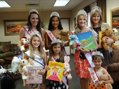 NAM Queens donate books and bears to The New Life Center