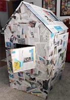 casita de papel periodico y carton para el jardin de la casa