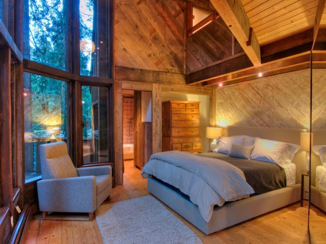 Photo of bedroom inside of tree house in the forest