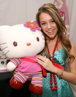 Miley Cyrus (Hannah Montana) with Hello Kitty plush doll soft toy