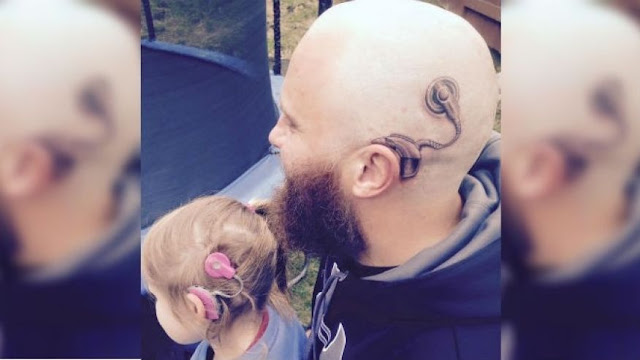 Father's cochlear implant Tattoo supporting deaf daughter who wears a Real Cochlear implant