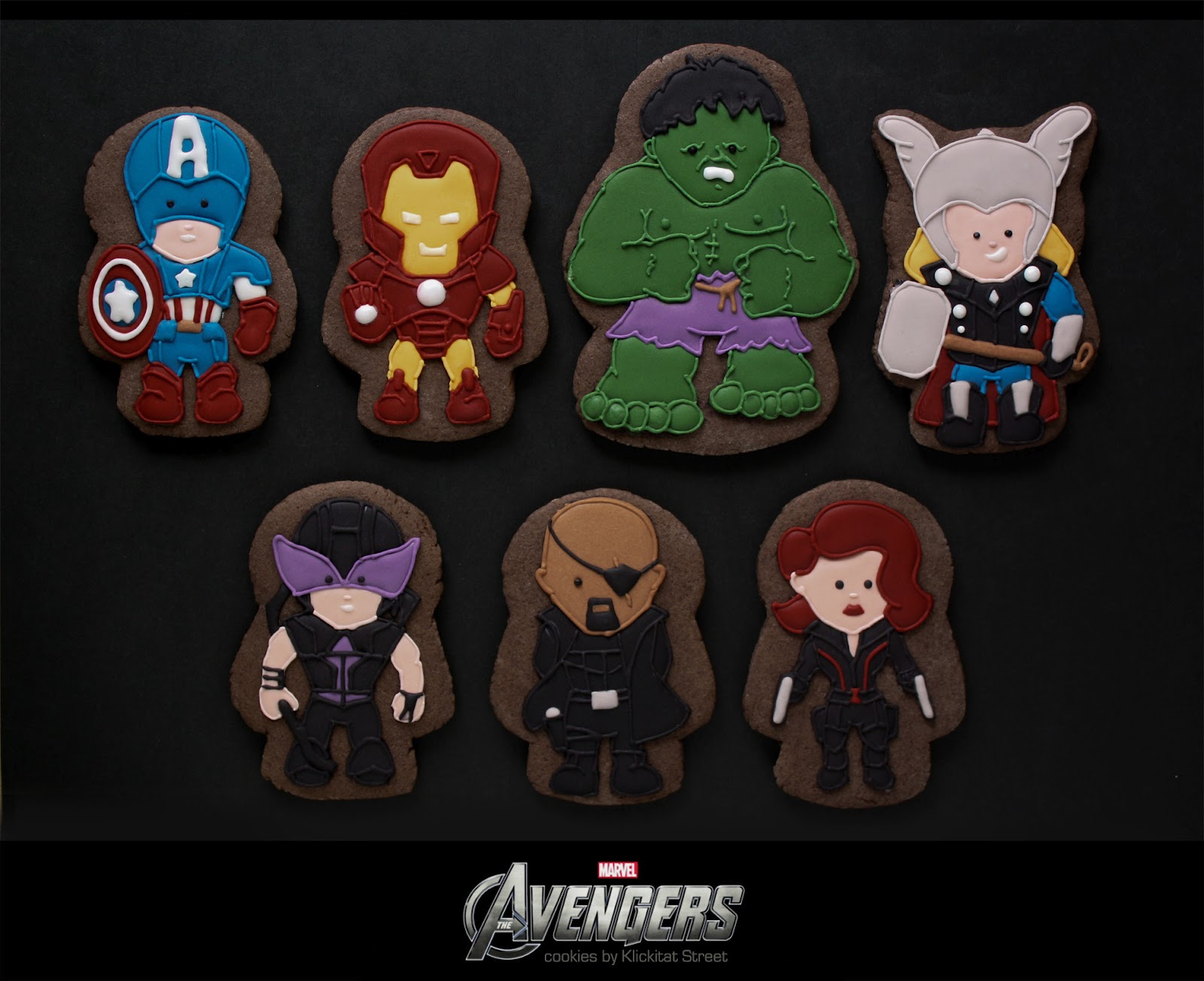 decorated sugar cookies of Marvel Avengers characters Iron Man, Captain America, Thor, Hulk, Hawkeye, Nick Fury, and Black Widow