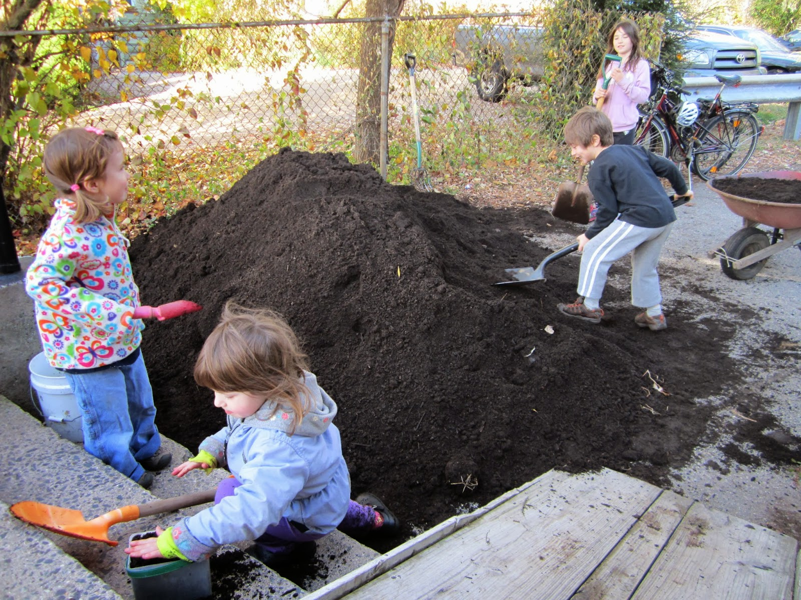 Students working in the Longfellow School Garden