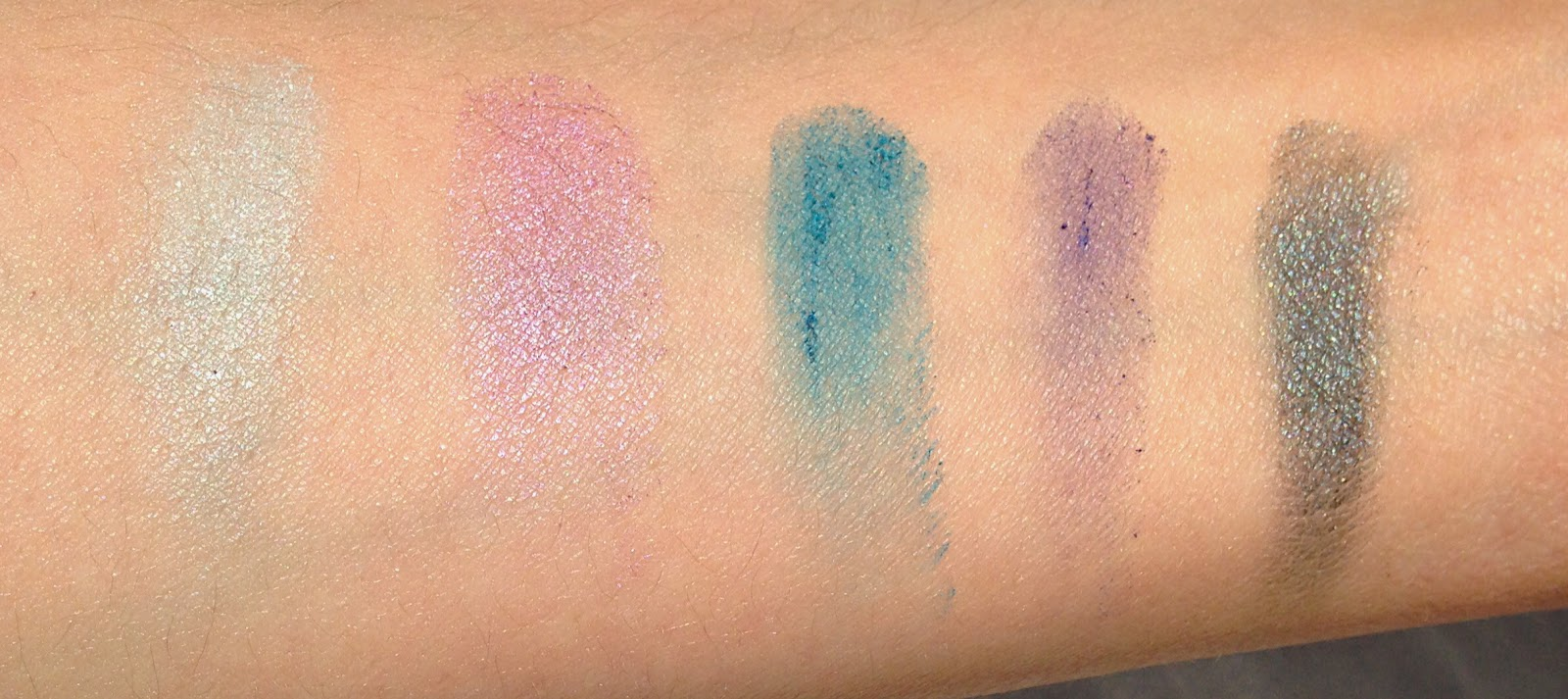Swatches of the Forever 21 Love and beauty eye shadow palette