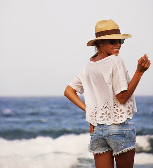 flowy white blouse denim shorts festival fashion
