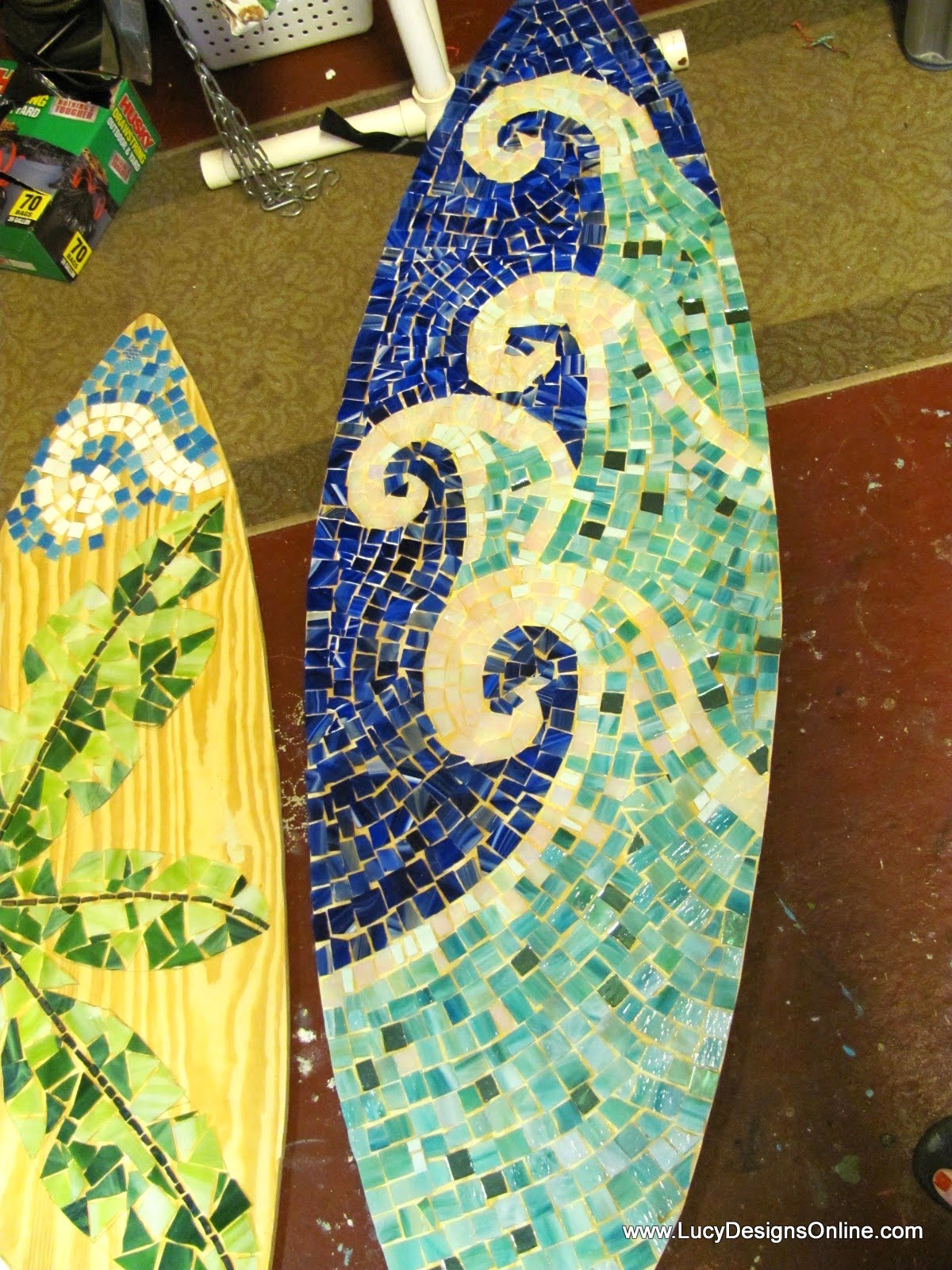 stained glass mosaic surfboard on wood base