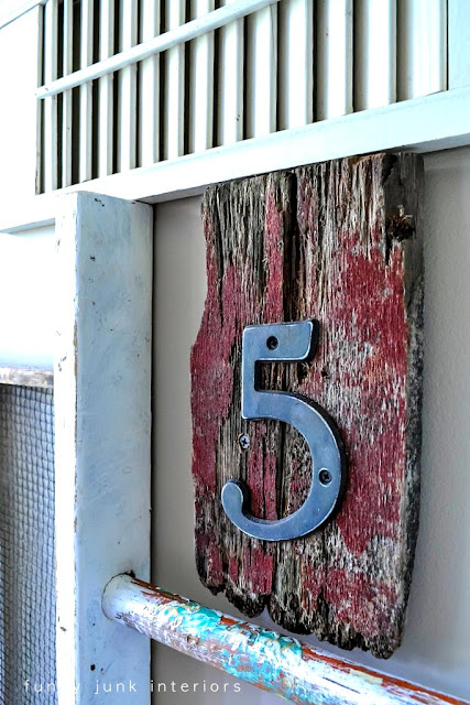 five rustic house number junk wall / Wall art with junk for coats - a unique entryway by FunkyJunkInteriors.net