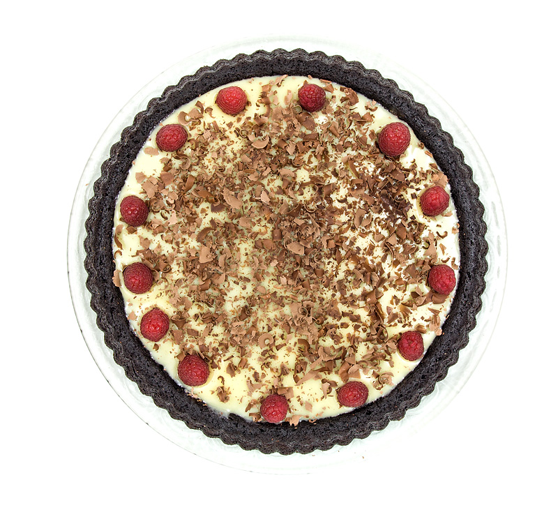 Triple chocolate cake raspberry top view