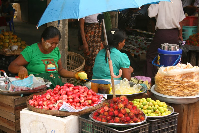 women selling fruit in Yangon's morning market