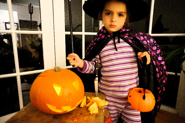 Picture of a Child Witch and Jack O Lantern