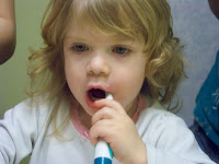 Cloey brushing her teeth